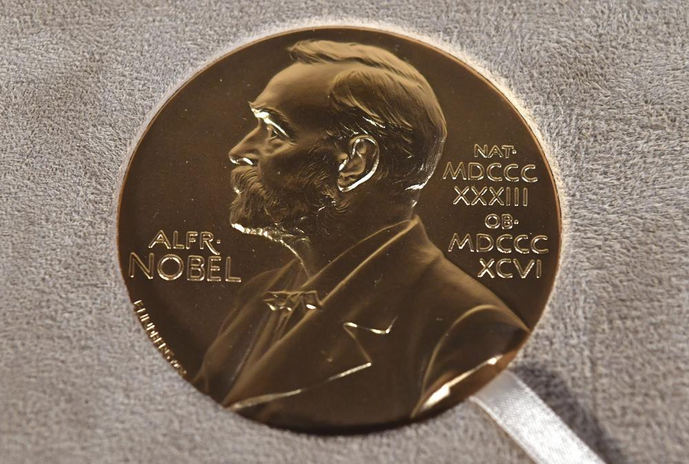 A Tuesday, Dec. 8, 2020 file photo of a Nobel medal displayed during a ceremony in New York. The Nobel Prize in Literature is due to be awarded on Thursday Oct. 7, 2021. (Angela Weiss/Pool Photo via AP, File)