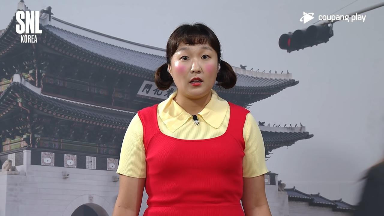 "Screenshot of comedian Lee Su-ji parodies an iconic doll from ""Squid Game."" (Coupang Play)"
