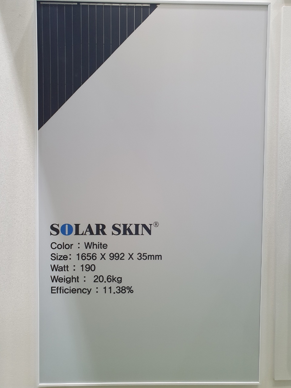 """Shinsung E&G's """"solar skin"""" panel is displayed on a white wall. (By Kim Byung-wook/The Korea Herald)"""
