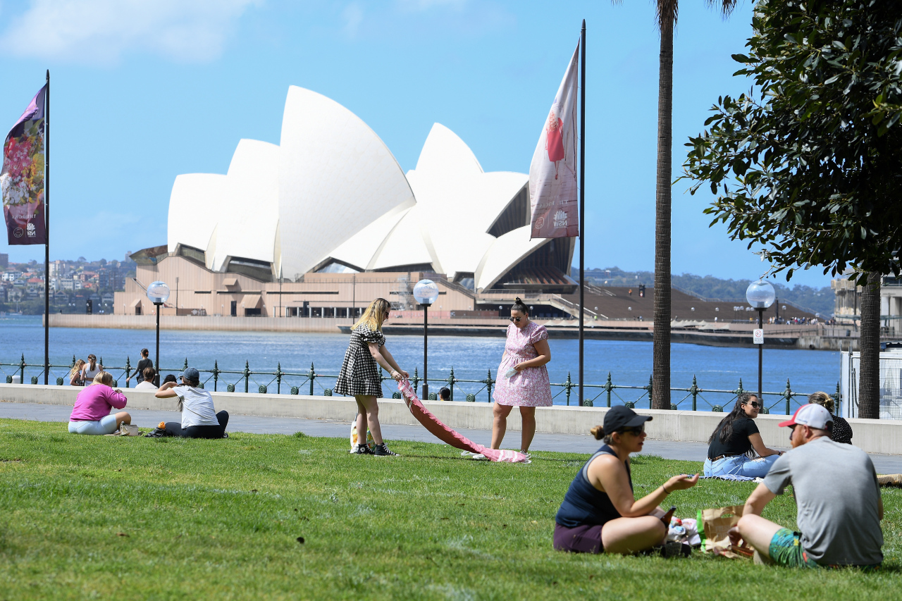A general view of people enjoying a picnic at the Museum of Contemporary Art Lawn, in Sydney, New South Wales, Australia, Sept. 25. (EPA-Yonhap)