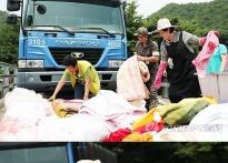 김정숙 여사 부상에도 조용한 봉사 vs 홍준표..