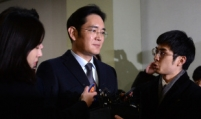 Prosecutors seek 12-year prison term for Samsung heir