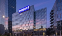Samsung's Q2 earnings more than halve on weak memory chips