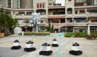Baemin introduces first outdoor delivery robot in apartment complex