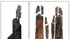 세로로 길쭉ㆍ검붉은 신라 방패 온전하게 첫 출토