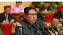 3면사진>북한 제8차 군수공업대회서 연설하는 김정은