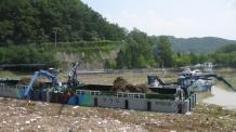 때 이른 5월 폭우..팔당호 부유쓰레기 700t 수거