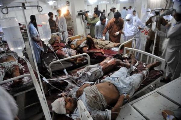 Blasts kill 34 in Pakistan, as CIA chief visits