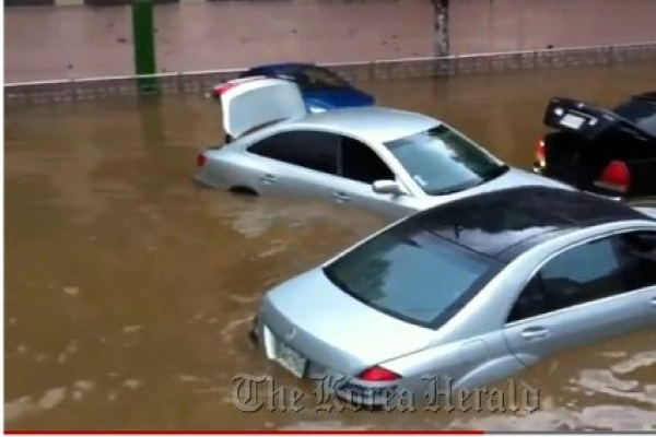 Auto insurers face claims from rain damage