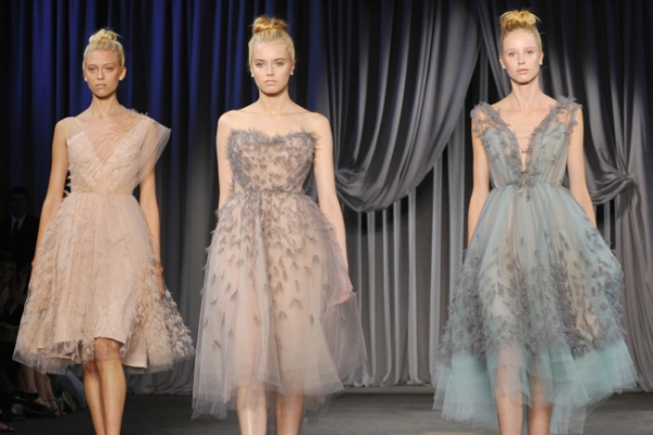 Showers at N.Y. Fashion Week, spring in their steps