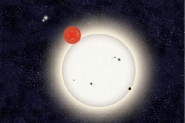 Distant planet found circling with 4 stars