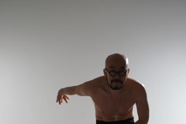 Fashion designer Lie Sang Bong poses nude