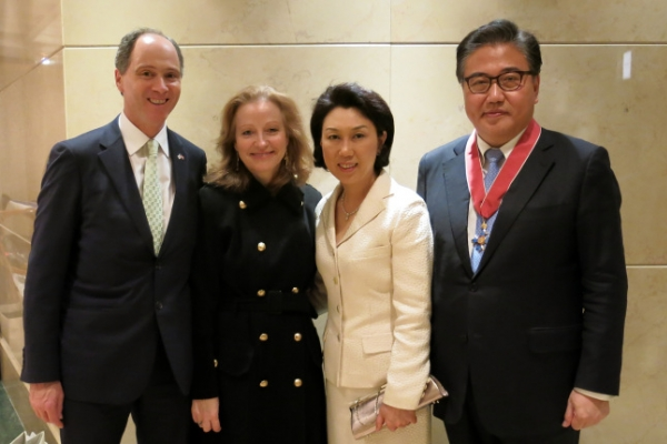 Former lawmaker awarded order of chivalry by British envoy
