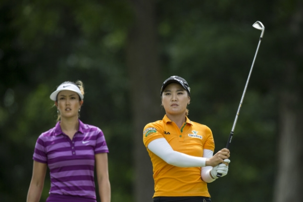 Wie leads rain-delayed Arkansas event