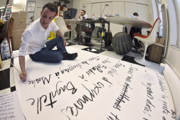 Calligrapher to fashion world's inviting hand