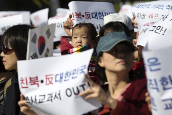 Ruling party links state textbook opponents to North Korea