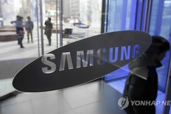 Samsung Q4 net tumbles on smartphone, chip woes