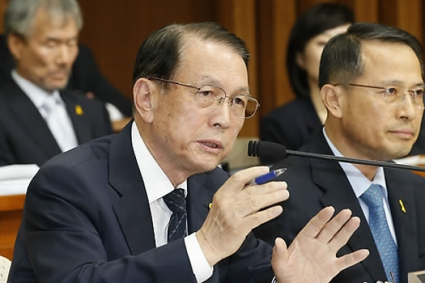 Ex-presidential chief of staff, aide under probe over influence-peddling scandal