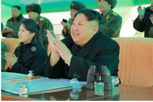 N. Korean leader, wife make appearance at air combat competition