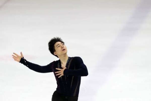 Ex-natl. figure skating champ headed to final Olympic qualifying event