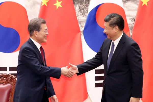 Moon, Xi vow no war on Korean Peninsula