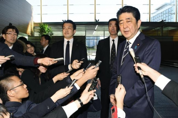 Abe to attend Olympics opening, hopes for summit with Moon