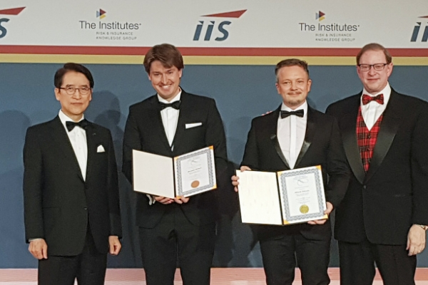 IIS honors co-authors of paper on digital insurance with Shin Award