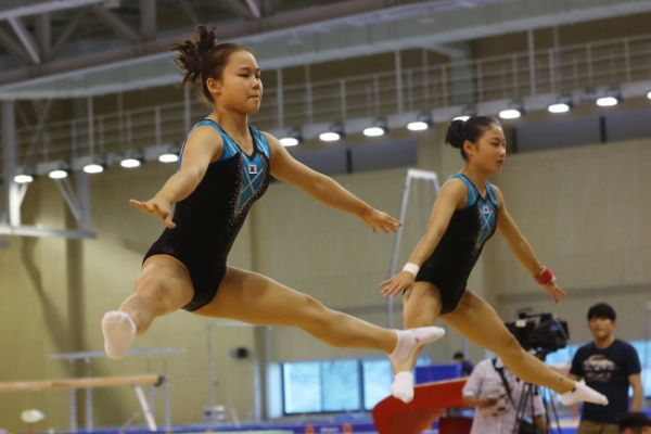 Daughter of ex-Olympic gymnastics medalist ready to move out of father's shadow