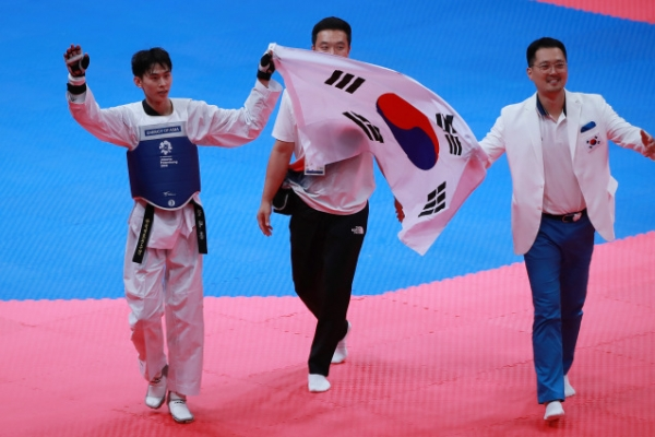 S. Korean taekwondo fighter Kim Tae-hun wins gold in men's 58kg