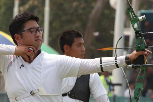 Kim Woo-jin wins gold in men's recurve archery