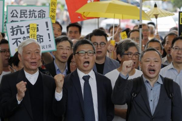 Hong Kong democracy leaders await Umbrella Movement verdict