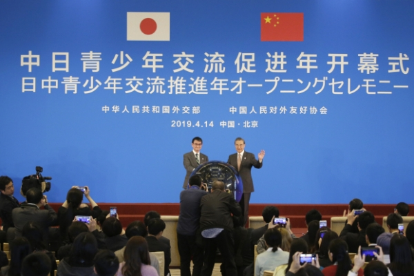 China, Japan tout 'recovered' ties amid global uncertainty