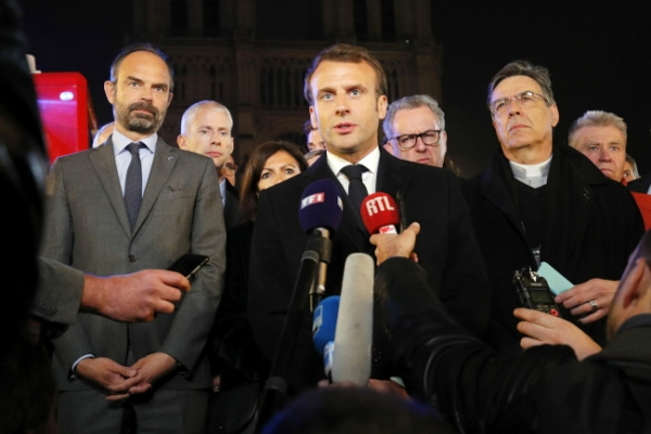 As Notre Dame smolders, Macron vows to rebuild
