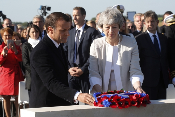 Macron praises May and looks beyond Brexit on D-Day
