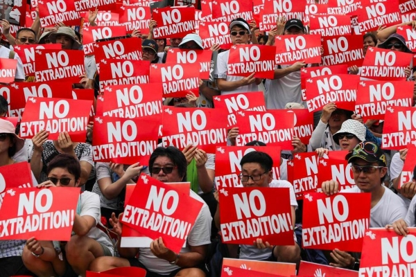 Violence mars end of huge Hong Kong protest against China extradition