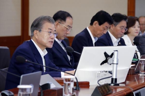 Moon defends PM's overseas trips