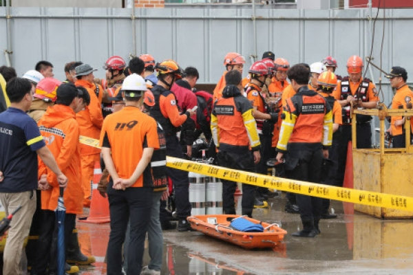 Heavy downpour kills one at construction site