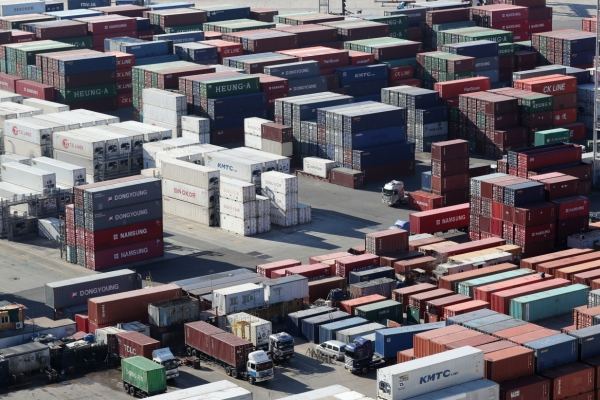 Exports down for 8th straight month amid trade dispute, chip slump