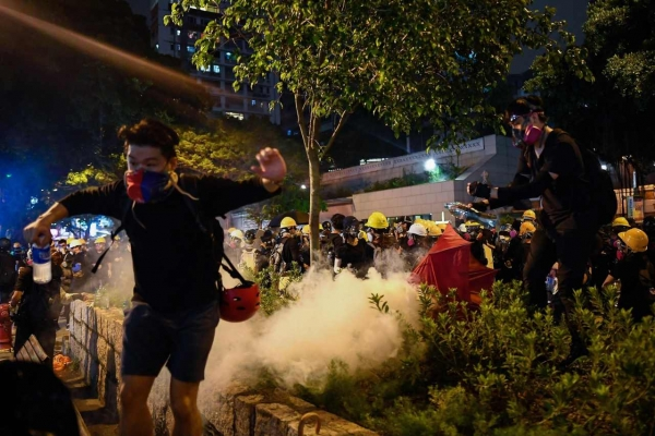 Hong Kong mops up after weekend of violence, braces for more protests