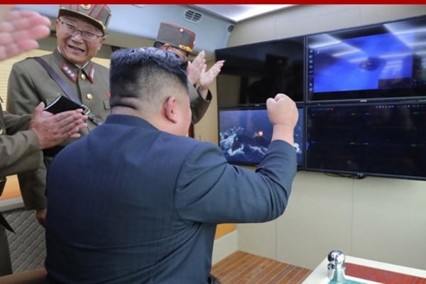 N. Korea says it tested 'new weapon' under leader Kim's guidance
