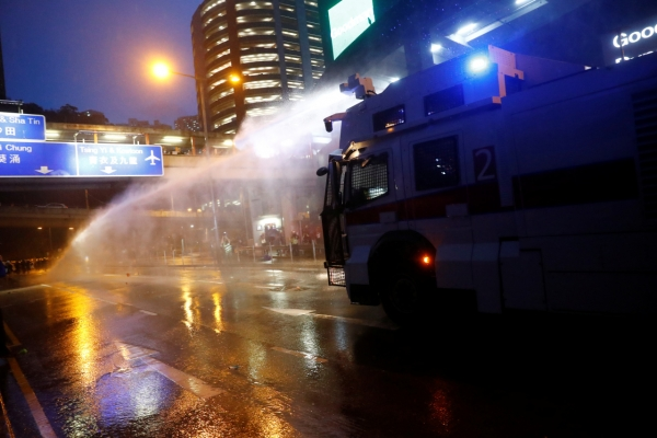 HK police say radical protesters forced use of water cannon, warning shot