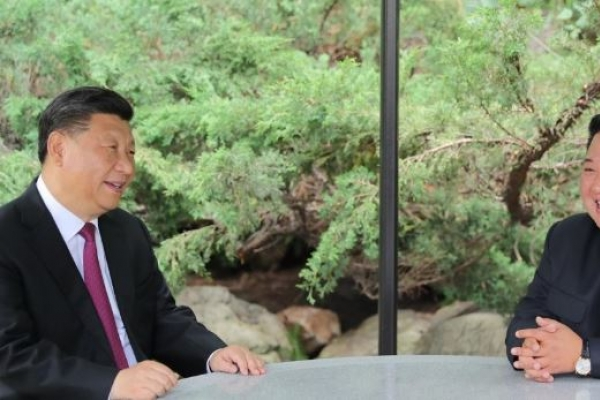 Kim vows to 'always stand by' China in message to Xi