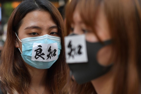 Hong Kong leader bans masks in hardening stance on protests