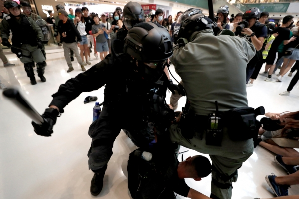 Five wounded as knife attack caps day of Hong Kong political chaos