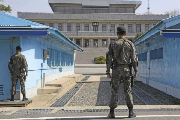 Two North Koreans deported as probe finds mass murder charge