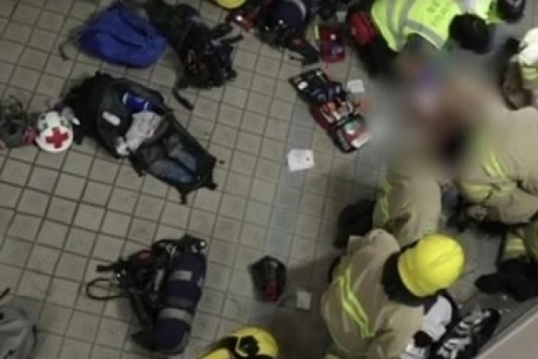 Hong Kong student who fell during protest clashes dies