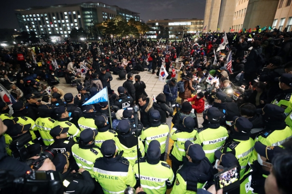 Police investigate protests at National Assembly premises