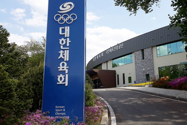 Olympic athletes' return to training center delayed by surge in coronavirus cases