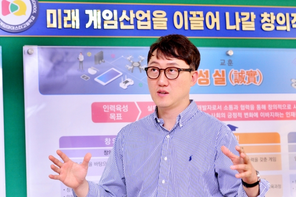 [Herald Interview] A principal's vision: From teaching to coaching students to develop games