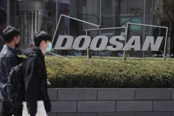 Doosan to raise W1tr by selling shares, assets